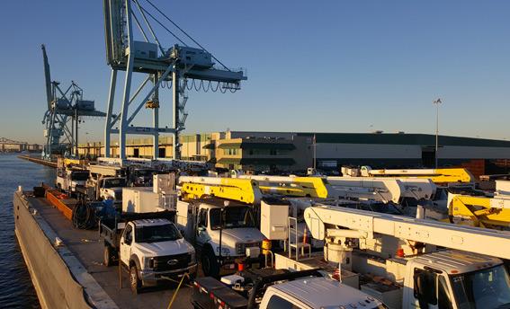 dann-ocean-towing-relief-barge-carrying-utility-trucks