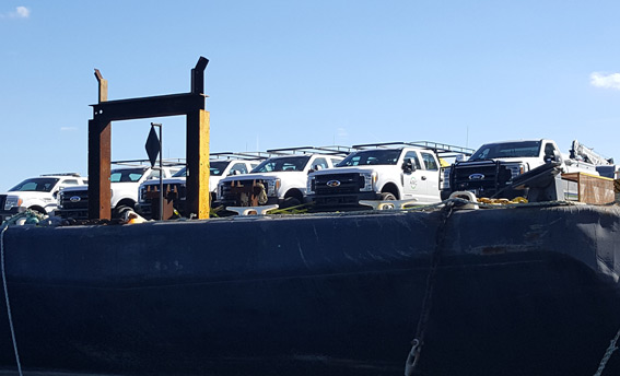 dann-ocean-towing-relief-barge-carrying-trucks